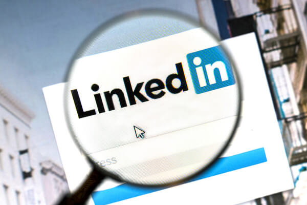 Ostersund, Sweden - August 1, 2015: Linkedin website under a magnifying glass. Linkedin is a business oriented social networking website.